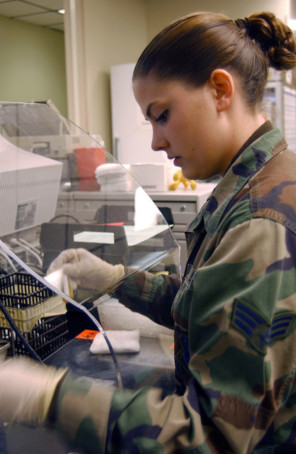 US Air Force (USAF) SENIOR AIRMAN (SRA) Cymbra Sommer, Laboratory Technician, 31st Medical Support Squadron, Aviano Air Base, Italy, processes a specimen for shipment inside the base clinic