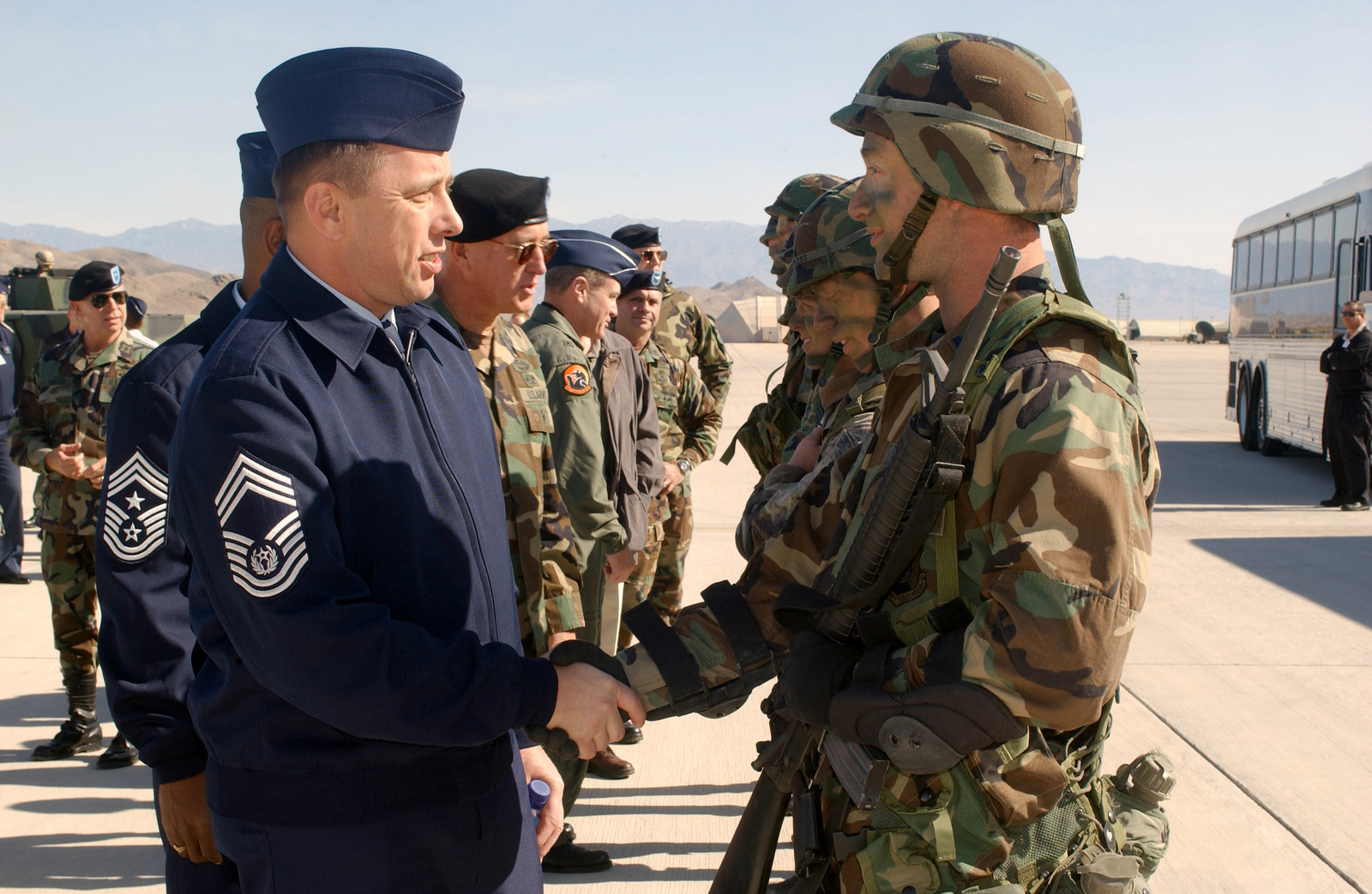 CHIEF MASTER Sergeant of the Air Force (CMSAF) Frederick J. Finch congratulates members of the 820th Security Forces Squadron (SFS) after their Paradrop demonstration at Point Bravo, during Capstone firepower demonstration at Indian Springs Air Force Auxiliary Air Field. It is a quarterly demonstration of aerial firepower and how it can be applied to the battlefield