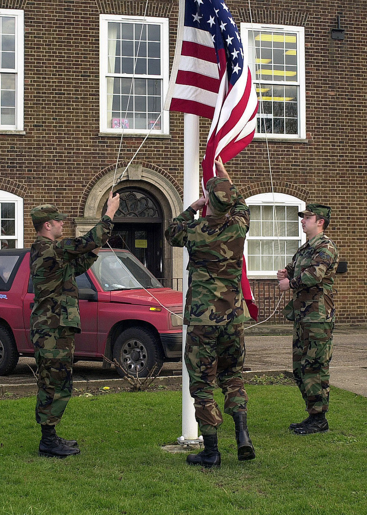 Students attending Mathies AIRMAN Leadership School (ALS), RAF Feltwell, United Kingdom, lower the British Royal Air Force ENSIGN Flag, during a retreat ceremony. ALS prepares SENIOR Airmen for positions of greater responsibility by providing leadership skills required of supervisors and reporting officials. The course consists of twenty-four academic days with one hundred and ninety-one hours of instruction