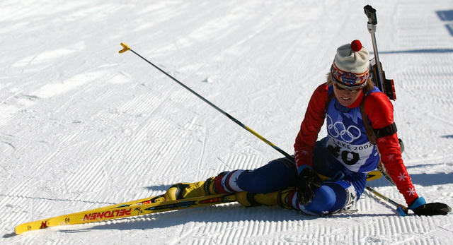 The course takes its toll on National Guard SPECIALIST (SPC) Kara Salmela, USA, who sits exhausted at the finish line of the women's 15km Biathlon event held at Soldier Hollow in Midway, Utah, during the 2002 WINTER OLYMPIC GAMES. SPC Salmela finished a disappointing 59th overall out of 69 competitors with a time of 57:25.9