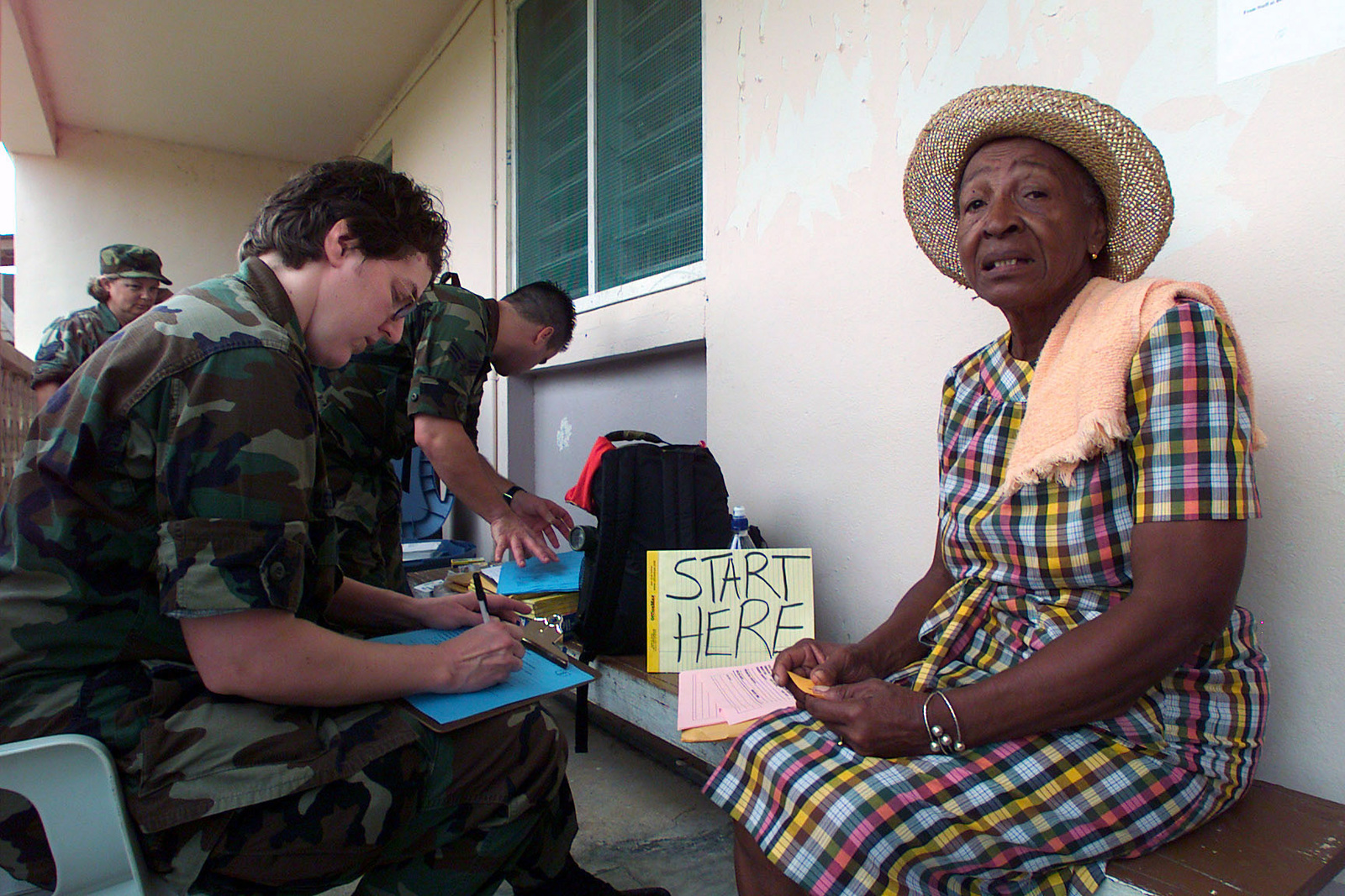 US Air Force (USAF) Captain (CPT) Patricia J. Beebe (left), 146th Medical Squadron, California Air National Guard (ANG) records a patients vital information outside the Punta Gorda Hospital, at Punta Gorda, Belize, during a 15-day Medical Humanitarian Operation called Medrete 03. During the Operation over 3,600 patients were treated and help was deliver to people affected by Hurricane Iris