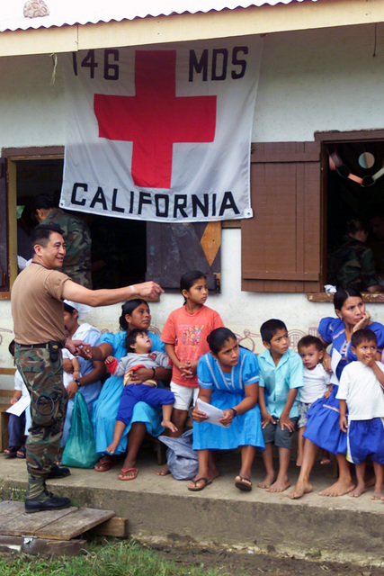 US Air Force (USAF) Captain (CPT) Jose R. D. Cabrera, a Nurse from the 146th Medical Squadron, California Air National Guard (ANG), helps directs patients towards the next treatment station at Blue Creek, Belize, during a 15-day Medical Humanitarian Operation called Medrete 03. During the Operation over 3,600 patients were treated and help was deliver to people affected by Hurricane Iris