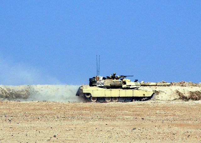 An M1A2 Abrams Main Battle Tank (MBT) patrols the border between Kuwait and Afghanistan on February 14, 2002. Since US troops liberated Kuwait from an Iraqi incursion 11 years ago, the US military has maintained a presence to deter any other Iraqi aggression