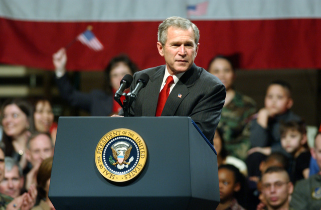 "On his way to Japan, US President George W. Bush stopped at Elmendorf AFB, Alaska, where he spoke to an enthusiastic full house in Hanger 3. The President voiced his pride in the US forces; ""Im honored to be in a place where people understand the need for sacrifice and patriotism,"" said the President. He also spoke about the role of Elmendorf AFB and Alaska in Operation NOBLE EAGLE and the war against terrorism"