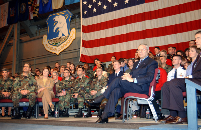 Secretary of State Colin L. Powell and Mrs. Laura Bush (right) watch as the President addresses a full house in Hangar 3 at Elmendorf AFB, Alaska. He spoke about the role of Elmendorf AFB and Alaska in Operation NOBLE EAGLE and the war against terrorism