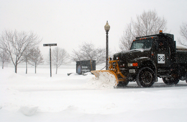 US Air Force (USAF) Airmen assigned to the 11th Civil Engineering (CE) Squadron use a snow plow to clear streets near the Defense Intelligence Agency at Bolling Air Force Base (AFB), Washington, District of Columbia (DC), after a winter snowstorm dumped over 16-inches of snow onto the area, in a two-day period. The storm is recorded as the sixth largest to hit the area in recent history