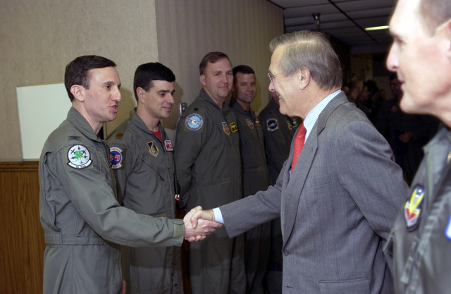 The Honorable Donald H. Rumsfeld, U.S. Secretary of Defense shakes hands with U.S. Air Force COL. Jerry Siegel, deployed force commander, 3rd WING, Elmendorf AFB, Alaska, during a visit to RED FLAG, at Nellis AFB, Nevada. (U.S. Air Force photo by TECH. SGT. Robert W. Valenca) (Released)