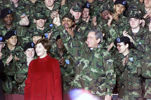 American armed forces personnel greet US President George W. Bush and First Lady Laura Bush during their visit to Osan Air Base, Republic of Korea