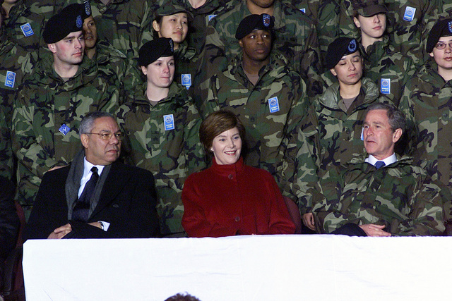 Secretary of State Colin Powell (left), First Lady Laura Bush and US President George W. Bush visit American armed forces personnel at Osan Air Base, Republic of Korea