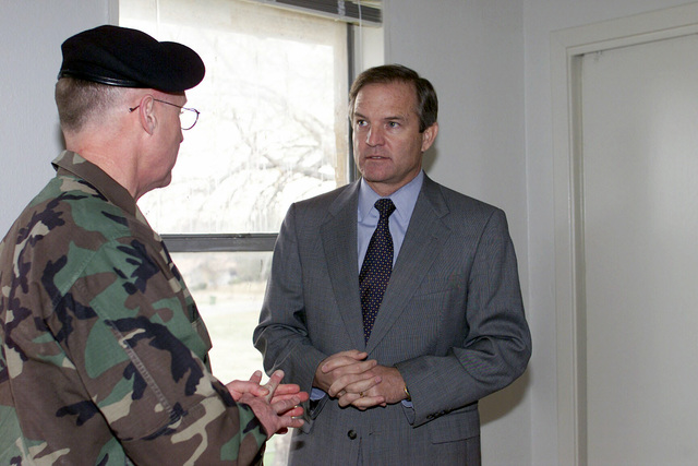 US Army (USA) Colonel (COL) Michael Pratt (left) and US Congressman The Honorable Chet Edwards, 11th Congressional District, Texas, tour the interior of a renovated home, during the dedication of the model home for the Residential Community Initiative program at McNair Village, Fort Hood, Texas (TX)