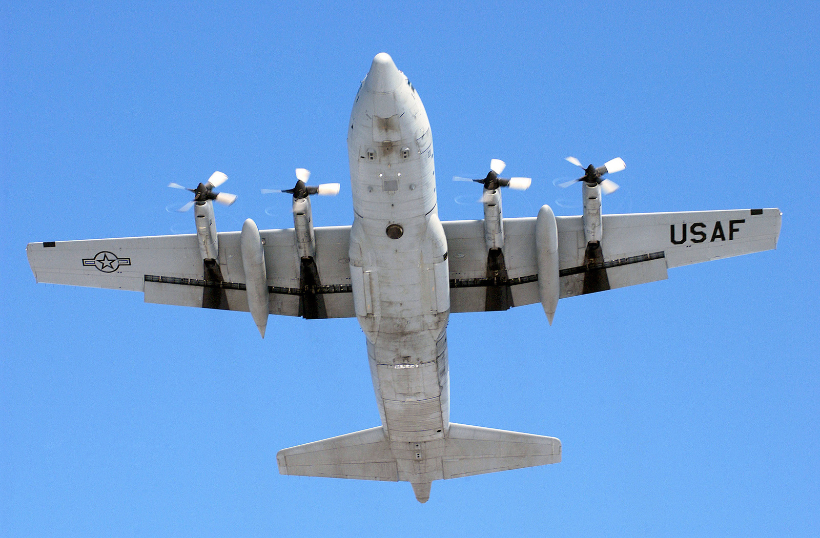 A US Air Force (USAF) C-130 Hercules aircraft from the 127th Wing, Michigan Air National Guard (ANG) flies directly over the camera at Selfridge Air National Guard Base (ANGB), Michigan (MI), during a training mission in support of Operation NOBLE EAGLE