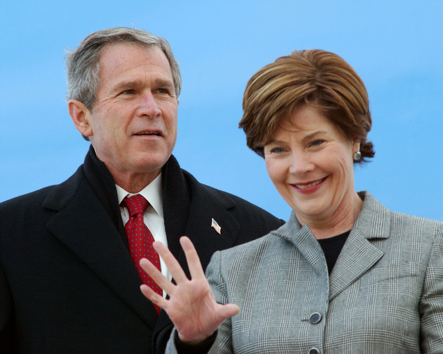 US President George W. Bush and First Lady Mrs. Laura Bush return from Beijing, China aboard Air Force One