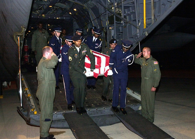 At approximately 11:45 PM (JST), The bodies of three US service members arrived at Kadena Air Base, Okinawa, Japan, onboard a C-130 Hercules. Aircrew members render a salute as an Army and Air Force joint honor guard team, carry one of the transfer cases off the aircraft. Names are being with held pending notification to next of kin. The three were recovered from the crash of a US Army MH-47E Chinook in the Bohol Sea near the island of Apo. The Chinook carried eight US Army personnel, 160th Special Operations Aviation Regiment, Fort Campbell, Kentucky, and two US Air Force para-rescue jumpers, 320th Special Tactics Squadron, Kadena Air Base, Japan