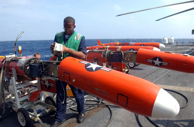 US Navy (USN) Aviation Machinist's Mate (AD) AIRMAN (AN), Jamar Sharp, assigned to Fleet Composite Squadron Six, assembles BQM-74E target drones on board the Guided Missile Frigate USS Doyle (FFG 39), in preparation for the upcoming 43rd annual UNITAS live fire exercises. UNITAS is the largest multi-national naval exercise conducted with naval forces from the Caribbean Sea, South and Central America and the USN. The exercises focus on building multinational coalition while promoting hemispheric defense and mutual cooperation