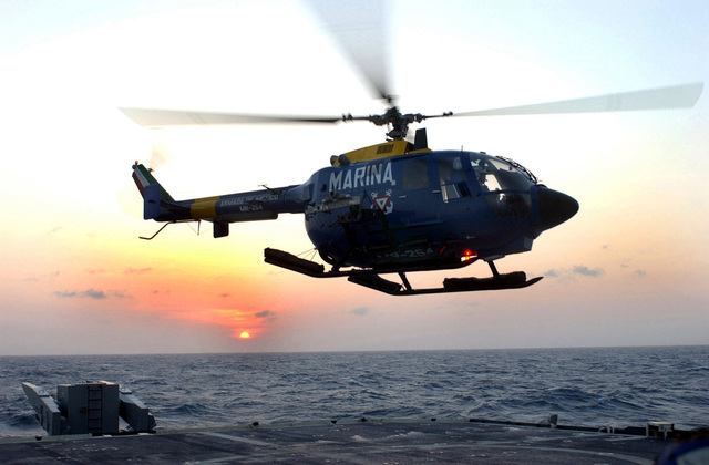 A Mexican Navy MBB BO-105CB helicopter takes off from the deck of the US Navy (USN) Guided Missile Cruiser USS YORKTOWN (CG 48) during the 43rd annual UNITAS exercise. UNITAS is the largest multi-national naval exercise conducted with naval forces from the Caribbean Sea, South and Central America and the USN. The exercises focus on building multinational coalition while promoting hemispheric defense and mutual cooperation