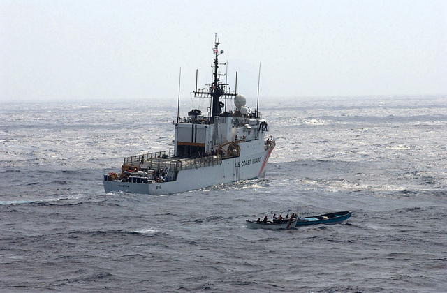 The US Coast Guard (USCG) FAMOUS CUTTER CLASS; Medium Endurance Cutter USCG THETIS (WMEC 910) provides covers as a boarding team aboard a whale boat moves in for a closer look at a small boat carrying simulated illicit contraband, while participating in the 43rd annual UNITAS exercises. UNITAS is the largest multi-national naval exercise conducted with naval forces from the Caribbean Sea, South and Central America and the USN. The exercises focus on building multinational coalition while promoting hemispheric defense and mutual cooperation