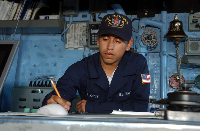 US Navy (USN) Quartermaster (QM) SEAMAN (SN) Recruit, Francis Florez, plots out a change in course onboard the bridge of the Guided Missile Cruiser USS Yorktown (CG 48), during the 43rd annual UNITAS exercises. UNITAS is the largest multi-national naval exercise conducted with naval forces from the Caribbean Sea, South and Central America and the USN. The exercises focus on building multinational coalition while promoting hemispheric defense and mutual cooperation