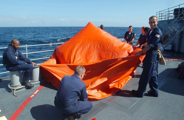 "US Navy (USN) sailors inflate a floating target commonly called the ""Killer Tomato"" on the fantail of the Guided Missile Cruiser USS Yorktown (CG 48) in preparation for a gunnery exercise during the 43rd annual UNITAS live fire exercises. UNITAS is the largest multi-national naval exercise conducted with naval forces from the Caribbean Sea, South and Central America and the USN. The exercises focus on building multinational coalition while promoting hemispheric defense and mutual cooperation"