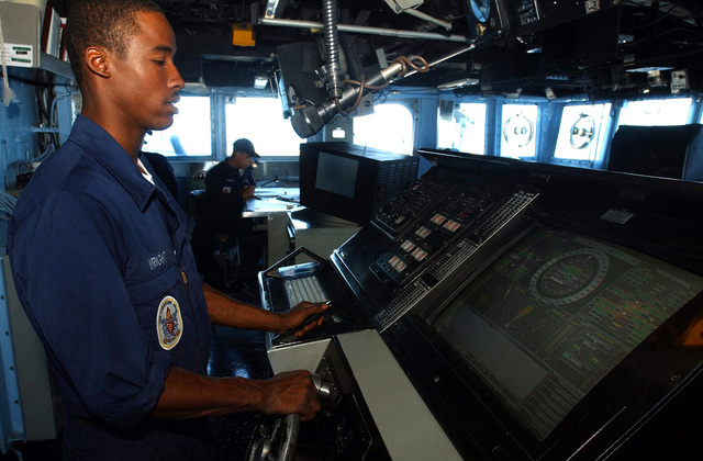 US Navy (USN) SEAMAN (SN) Recruit, Danny Wright mans the helm onboard the bridge of the Guided Missile Cruiser USS Yorktown (CG 48), during the 43rd annual UNITAS exercises. UNITAS is the largest multi-national naval exercise conducted with naval forces from the Caribbean Sea, South and Central America and the USN. The exercises focus on building multinational coalition while promoting hemispheric defense and mutual cooperation