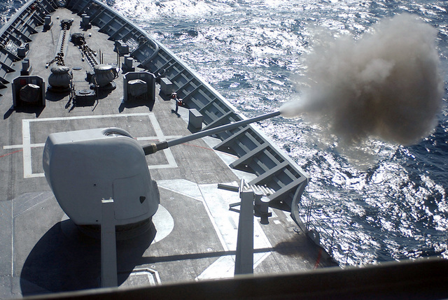 The US Navy (USN) Ticonderoga Class Guided Missile Cruiser USS YORKTOWN (CG 48) fires her 5-inch gun at a target during a gunnery exercise. YORKTOWN is underway in the Caribbean Sea participating in the 43rd annual UNITAS exercise. UNITAS is the largest multi-national naval exercise conducted with naval forces from the US, the Caribbean Sea, and South and Central America. The exercises focus on building multinational coalitions while promoting hemispheric defense and cooperation