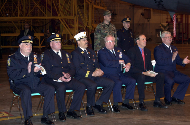 CHIEF Joseph Morris (seated left), New York/New Jersey Port Authority Police Departments; Deputy CHIEF Thomas P. Purtell, Commanding Officer, Special Operations Division, New York City Police Department; Deputy Assistant CHIEF Michael Weinlein, New York City Fire Department; US Air Force (USAF) Major General (MGEN) Thomas P. Maguire Jr., Adjutant General State of New York; The Honorable George E. Pataki, Governor State of New York; and US Air Force (USAF) Colonel (COL) Dana B. Demand, Commander, 105th Airlift Wing; show the appreciation during a dedication ceremony held at Stewart Air National Guard Base (ANGB), New York (NY)