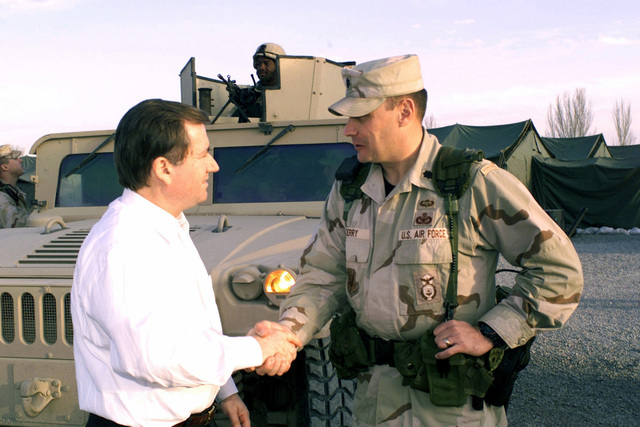 US Representative The Honorable Ed Royce, Republican (R) California (CA) shakes hands with US Air Force (USAF) Lieutenant Colonel (LCT) Donald Derry, Commander, 376th Air Expeditionary Wing (AEW) Security Forces Squadron (SFS), at Peter J. Ganci Jr. Air Base, Kyrgyzstan, during Operation ENDURING FREEDOM