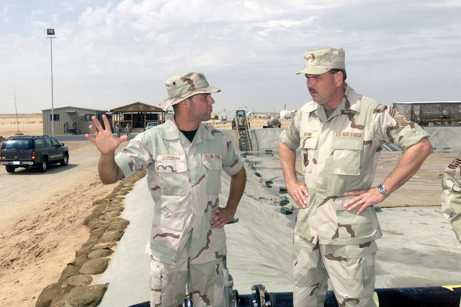CHIEF MASTER Sergeant (CMSGT) Daniel M. Keane, (right), USAF, Air Combat Command (ACC) Command CHIEF MASTER Sergeant, talks with AIRMAN First Class (A1C) Ryan Crossman, USAF, the 319th Supply Squadron (SUPS), Grand Forks AFB, North Dakota, deployed to the 363rd Expeditionary Supply Squadron (ESUPS), during a visit to Prince Sultan Air Base, Kingdom of Saudi Arabia