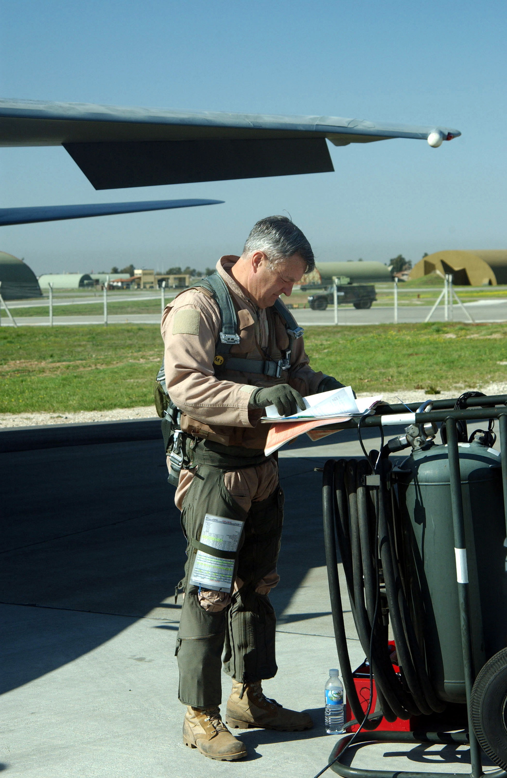 "US Air Force (USAF) Brigadier General (BGEN) Edward R. ""Buster"" Ellis, Co-Commander, Combined Task Force for Operation NORTHERN WATCH, checks his aircraft flight logbook, before a mission at Incirlik Air Base, Turkey"