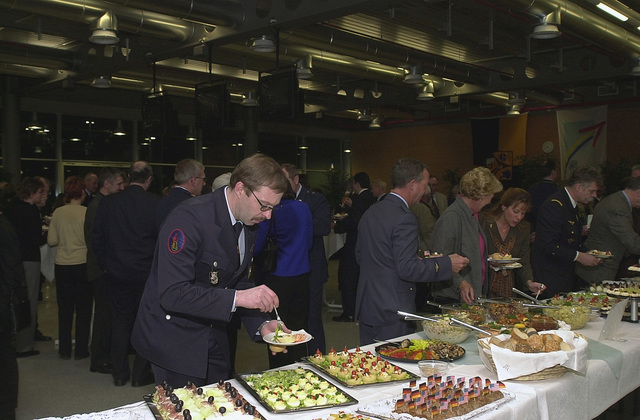 "Guests enjoy hors d'oeuvres at the reception ceremony for ""Grosser Zapfenstreich,"" the Grand Tattoo, at Ramstein Air Base, Germany, on March 8, 2002. The ceremony, attended by the Ramstein military community and guests from the local community, was a gift to the base from the German Armed Forces in recognition of the 50th anniversary of Ramstein Air Base"