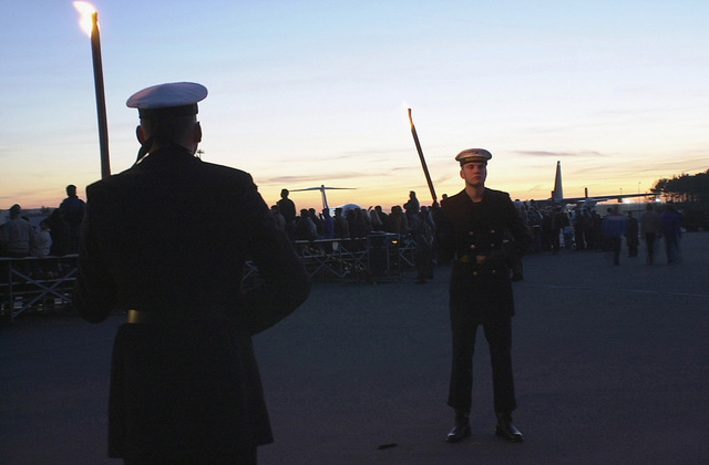 "Members of the German Armed Forces await the opening ceremony of ""Grosser Zapfenstreich,"" the Grand Tattoo, at Ramstein Air Base, Germany, on March 8, 2002. 360 torch-bearing members began the ceremony as the sunsets over the airfield. The ceremony, attended by the Ramstein military community and guests from the local community, was a gift to the base in recognition of the 50th anniversary of Ramstein Air Base"