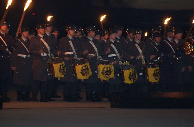 "Members of the German Armed Forces Band perform during the""Grosser Zapfenstreich,""a military tattoo held in recognition of the 50th Anniversary of Ramstein Air Base, Germany"