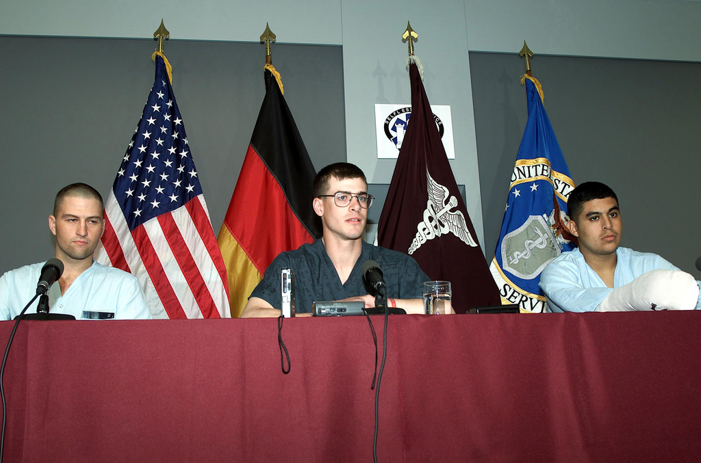 Sergeant (SGT) Robert John McCleave, US Army (USA), SPECIALIST (SPC) Wayne Stanton, USA, and SPC Ricardo Miranda, USA, members of the 10th Mountain Division (Light), answer media questions at the Landstuhl Regional Medical Center regarding their wounds suffered in fierce fighting in eastern Afghanistan