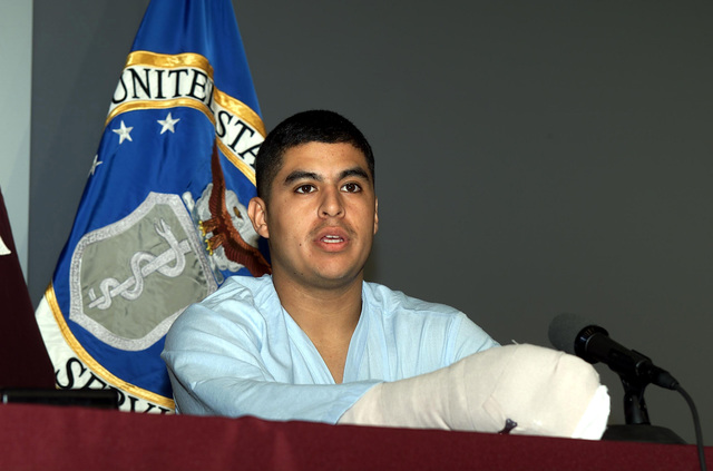 SPECIALIST (SPC) Ricardo Miranda, US Army (USA), 10th Mountain Division (Light), answers media questions at the Landstuhl Regional Medical Center regarding wounds he suffered in fierce fighting in eastern Afghanistan