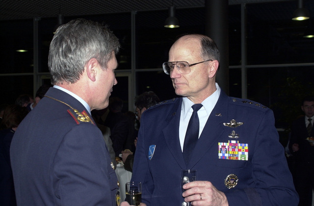 The CHIEF of STAFF of the German Air Force Lieutenant General (LGEN) Gerhard Back (left) and General (GEN) Gregory S. Martin, USAF, Commander, United States Air Forces in Europe, enjoy the festivities at a reception after a German Tattoo Ceremony at Ramstein Air Base