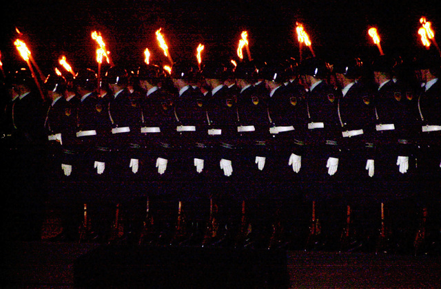 "The German Armed Forces present ""Grosser Zapfenstreich"" (Grand Tattoo), at Ramstein Air Base, Germany, on March 8, 2002. The 360 torch-bearing members began the ceremony as the sunset over the airfield. The ceremony, attended by the Ramstein military community and guests from the local community, is a gift to the base in recognition of the 50th anniversary of Ramstein Air Base. (Substandard image)"