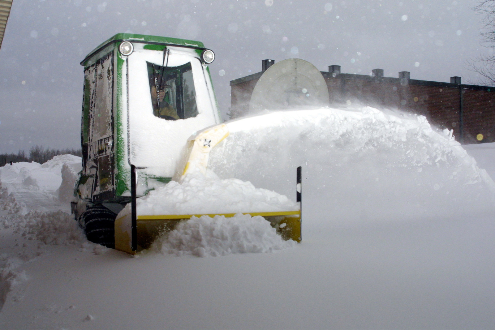 US Air Force (USAF) Technical Sergeant (TSGT) Michael Anderson, 148th Fighter Wing (FW) Minnesota Air National Guard (ANG) operates a John Deere F 911 snow blower at Duluth International Airport (IAP), Minnesota (MN)