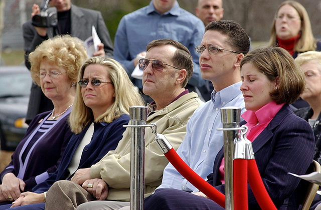 The family members of US Navy Lieutenant (LT) Jonas M. Panik attend the Memorial Ceremony honoring their loved one, held at the Piney Orchard Community Center, Memorial Flag Garden, in Odenton, Maryland. LT Panik, an Intelligence Officer was killed during the September 11th attack on the Pentagon