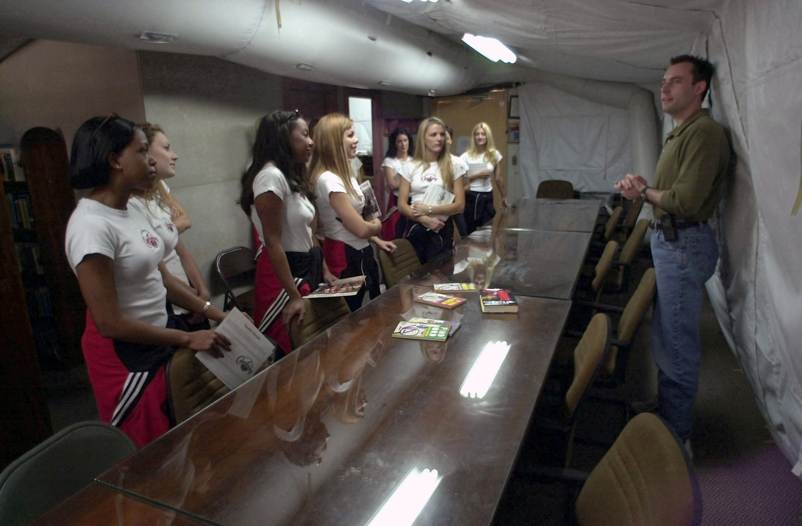 US Air Force (USAF) Captain (CPT) Shawn Campbell (right), Services CHIEF for Operation NORTHER WATCH, briefs members of the National Football League (NFL), Tampa Bay Buccaneers, Cheerleading Squad, during a tour of the facilities at Incirlik Air Base (AB), Turkey. Members of the squad are visiting with deployed military personnel in support of Operation ENDURING FREEDOM