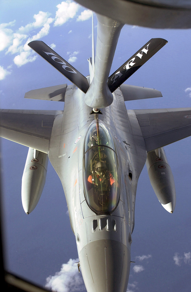 A Royal Norwegian Air Force F-16 Fighting Falcon aircraft connects to the refueling boom of a US Air Force (USAF) KC-135R Stratotanker from the 100th Air Refueling Wing (ARW), during a mission in support of Exercise STRONG RESOLVE 2002