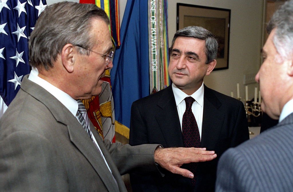 The Honorable Donald H. Rumsfeld (left), U.S. Secretary of Defense, meets with Armenian Minister of Defense Serchik Sarkisyan (center) at the Pentagon, Washington D.C., on Mar. 20, 2002.(DoD photo by Robert D. Ward)  (Released)