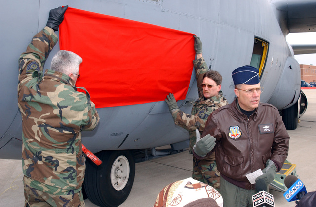 """US Air Force (USAF) Brigadier General (BGEN) Thomas G. Cutler (center), Commander, 127th Wing, addresses members of the local new media, regarding the new """"Lets Roll"""" logo that is about to be unveiled on one of the 127th Wings C-130 Hercules aircraft, on the flight line at Selfridge Air National Guard Base (ANGB) Michigan (MI)"""