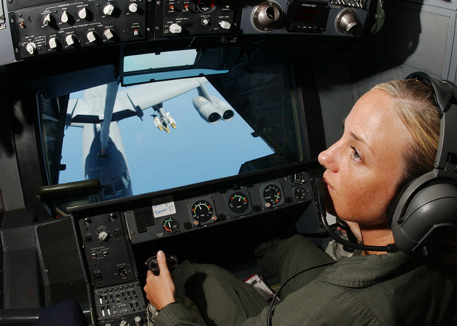 United States Air Force (USAF) STAFF Sergeant (SSGT) Michelle L. Buck, a Boom Operator aboard a KC-10 Extender with the 79th Aerial Refueling Squadron (ARS), 60th Air Mobility Wing (AMW), refuels a B-52H Stratofortress bomber returning from a mission in support of Operation ENDURING FREEDOM