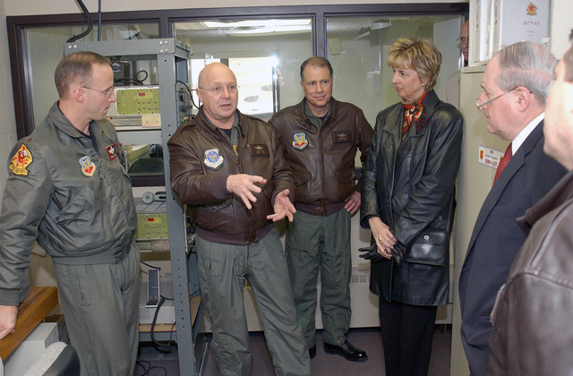 """Brigadier General (BGEN) Thomas Cutler, the 127th Wing Commander, explains operations to US Senator Carl Levin, from inside the operations room of an alert facility as Major (MAJ) Charles """"Chuckles"""" Dierkes, left, Colonel (COL) Mike Peplinski, Commander of the 107th Fighter Squadron (FS) and Barb Kozak, the Selfridge Starbase Director look on"""