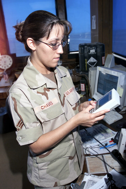 SENIOR AIRMAN (SRA) Debra Chaves, a weather technician with the 363rd Expeditionary Operation Support Squadron (EOSS) receives observations from a Tactical Automated Observing System (TAOS)