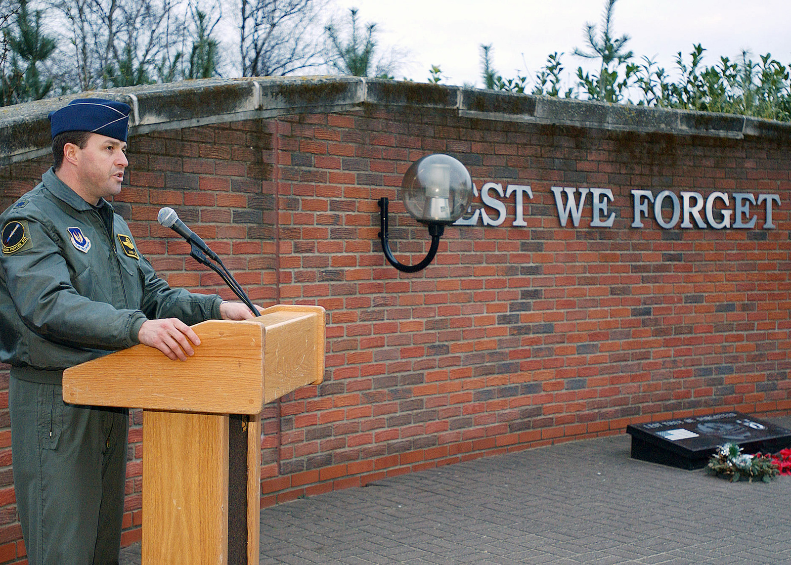 """Lieutenant Colonel (LCOL) Danny Lee, USAF, Pilot, 493rd Fighter Squadron (FS), 48th Fighter Wing (FW), Royal Air Force Lakenheath, United Kingdom, says a few words during a ceremony held at the Wings of Liberty Park. The ceremony was held to honor and remember LCOL Kenneth """"Buster"""" Hyvonen and Captain (CAPT) Kirk """"Jammer"""" Jones, whose F-15C crashed in the Scottish Highlands one year ago"""