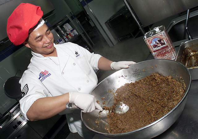 All in a days work as STAFF Sergeant (SSGT) Ernest Peralta, USAF, 31st Services Squadron (SVS), prepares porcupine meatballs for lunch at the Dolimetti Dining Facility at Aviano Air Base, Italy