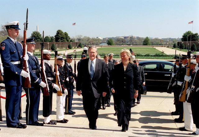 The Honorable Donald H. Rumsfeld (left), U.S. Secretary of Defense, escorts Kristin Krohn Devold, Norwegian Minister of Defense, through an Honor Cordon at the River Entrance of the Pentagon, Washington, D.C., April 2, 2002. (DoD photo by Helene C. Stikkel) (Released)