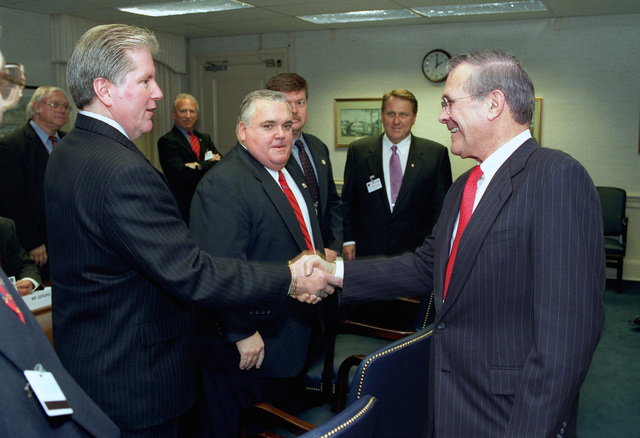 The Honorable Donald H. Rumsfeld (right), U.S. Secretary of Defense, shakes hands with Richard Brown(left), of the National Federation of Federal Employees, during a Department of Defense community outreach program at the Pentagon, Arlington, Va., on Apr. 3, 2002.(DoD photo by Robert D. Ward) (Released)