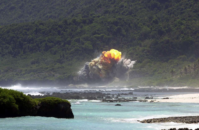 A fireball rises above the 36th Explosive Ordnance Disposal (EOD) Tarague range seconds after the detonation of an M117 bomb, as a part of the flight's training, on Andersen Air Force Base (AFB), Guam