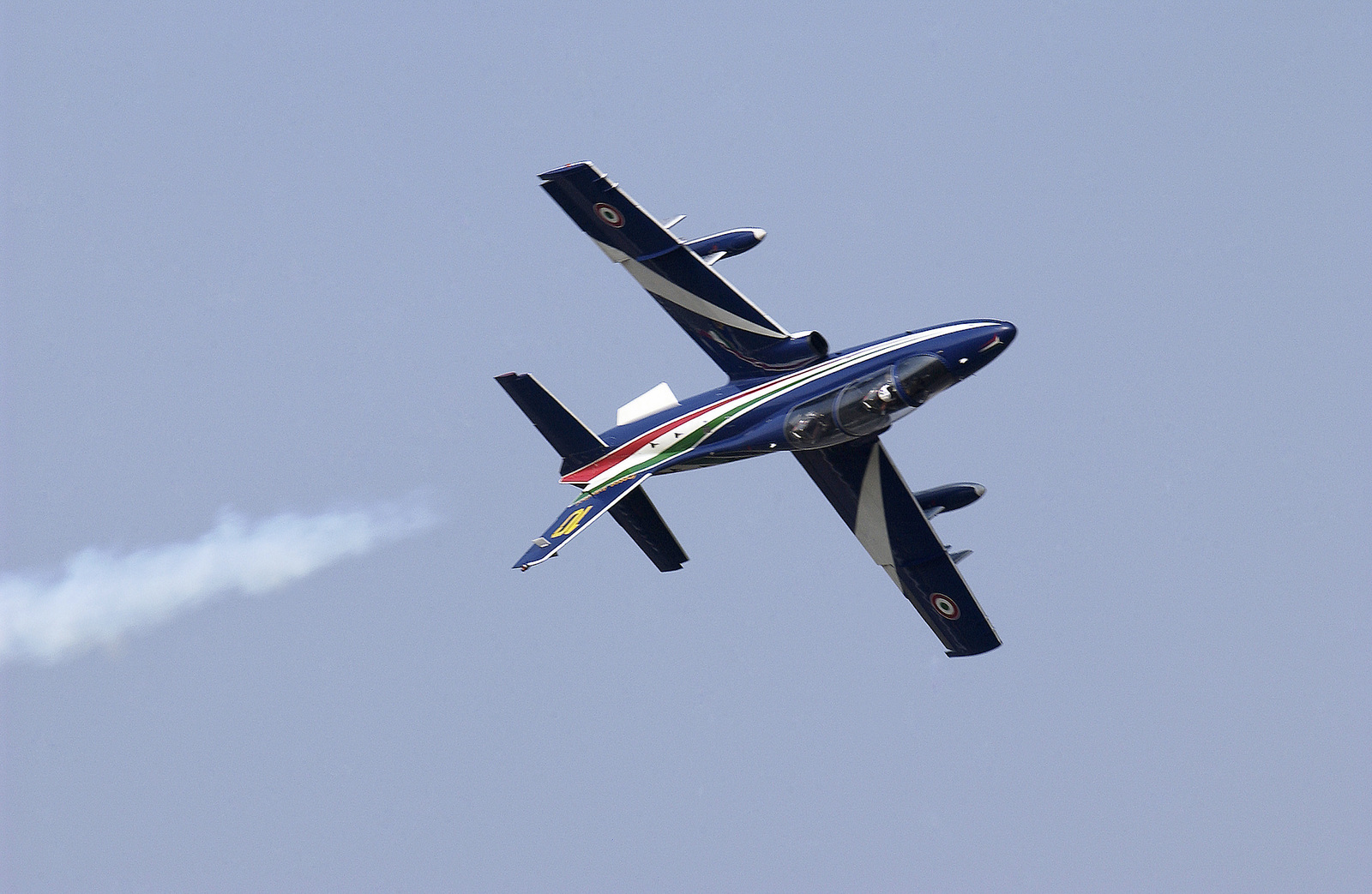 """The Italian National Aerobatics team called """"Frecce Tricolore"""" performs a mini air show for the United States Air Force (USAF) personnel at Aviano Air Base, including this solo performance, prior to their scheduled performance"""